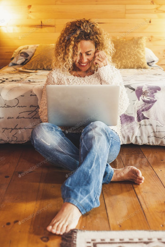 Cheerful people work at home or hotel room with computer