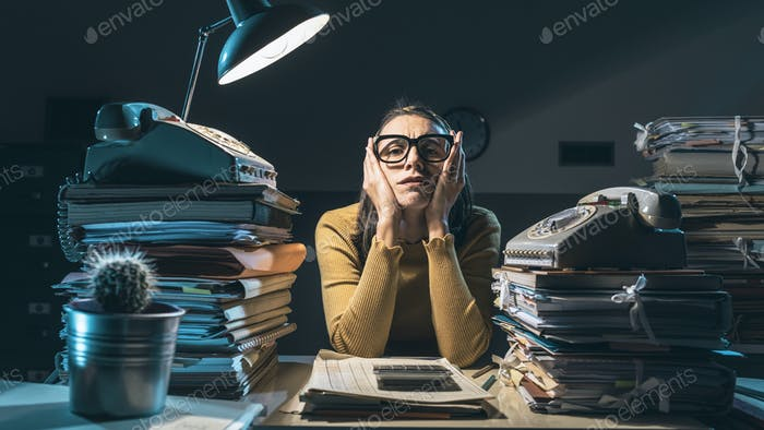 Exhausted businesswoman working late at night