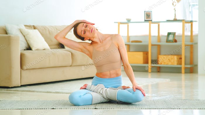 Young woman in sportswear doing yoga position