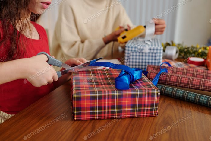 Girl wrapping presents