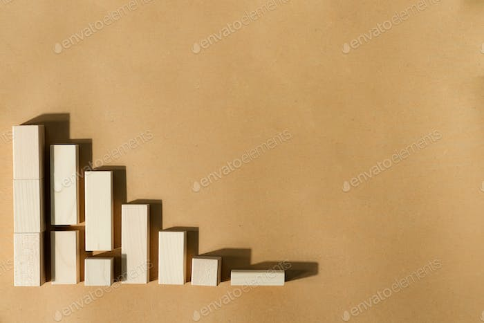 Geometric wooden figures as a financial chart