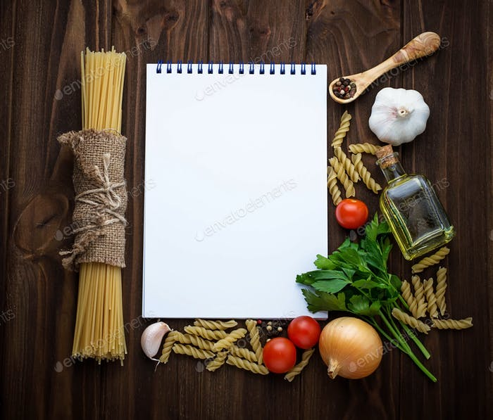 Tomato, pasta, garlic, parsley and empty notebook