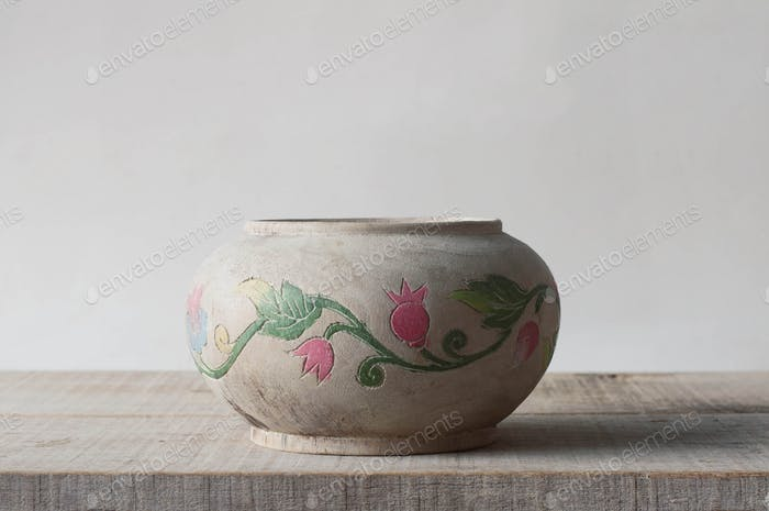 vase on wooden plate