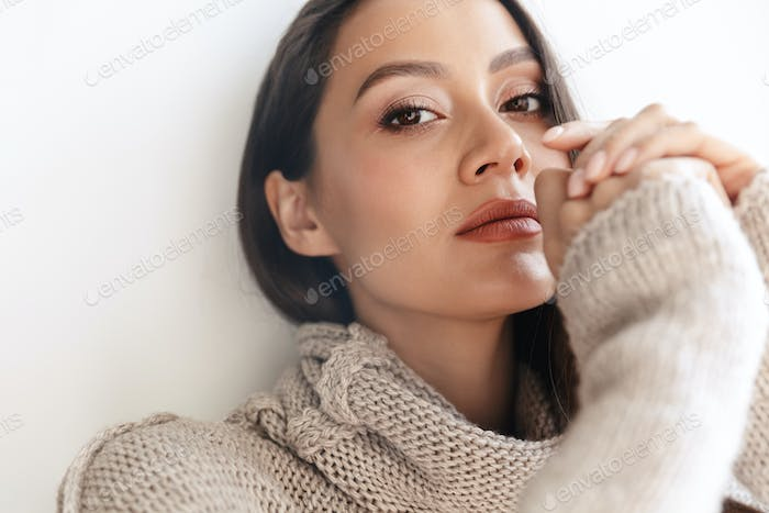 Image of seductive asian woman posing and looking at camera