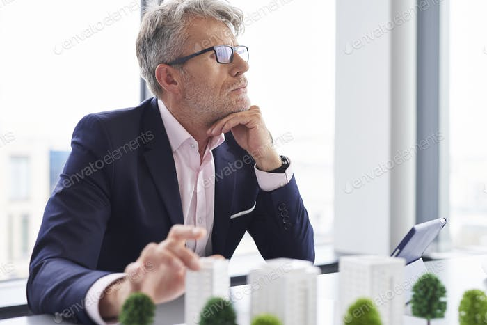 Busy senior businessman thinking about new solutions