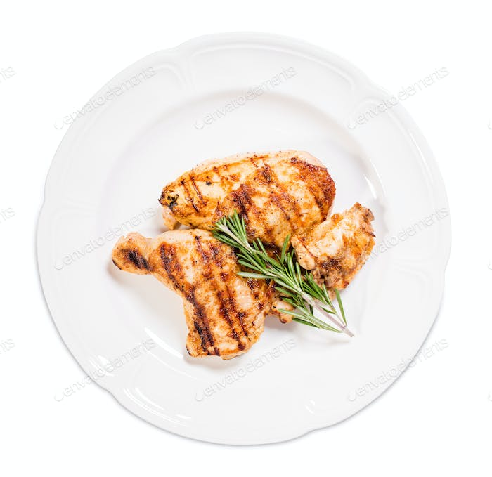 Grilled chicken fillet and legs with rosemary.