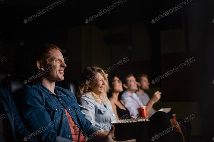 Group of people in multiplex movie theater