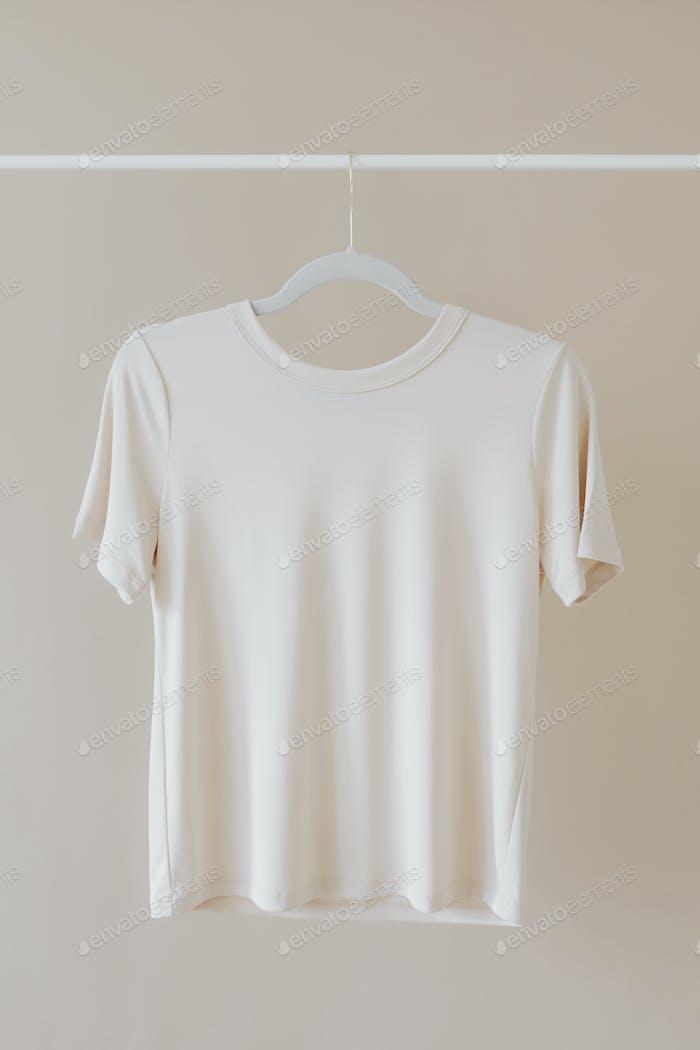 T-shirt mockup hanging on a clothing rack