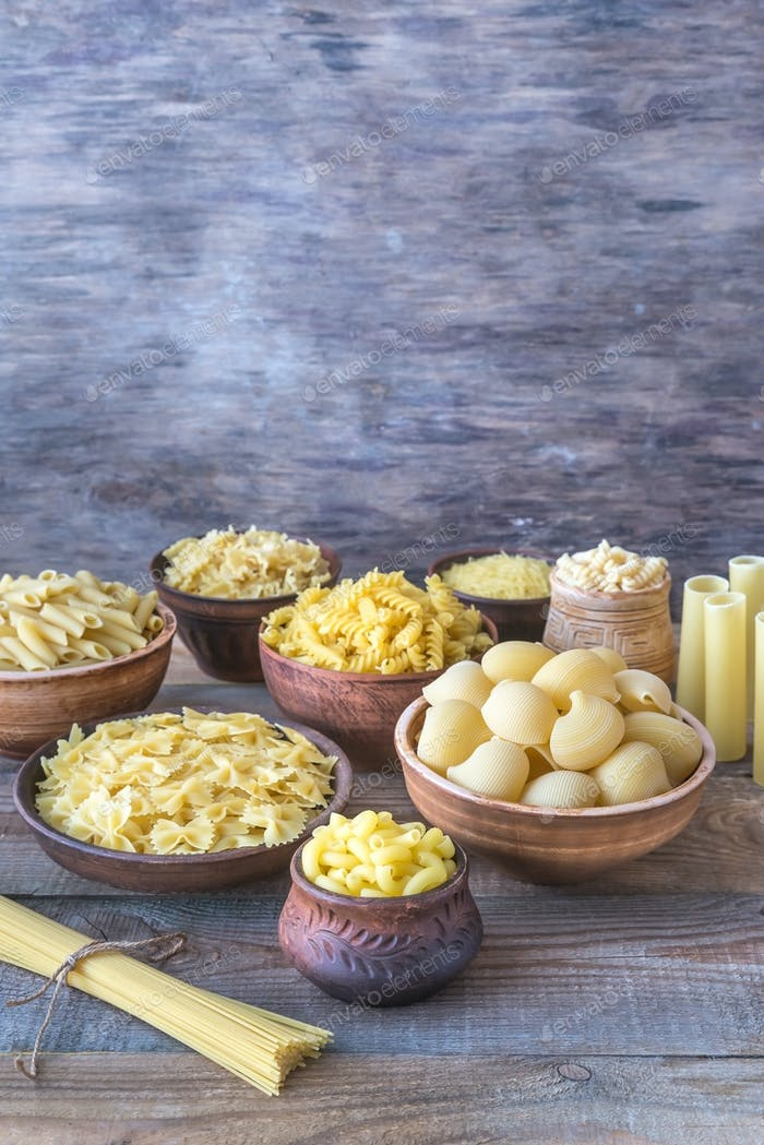Various types of pasta on the white background