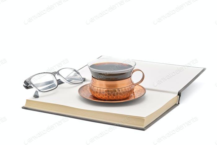 Kaffee mit Buch und Lesebrille