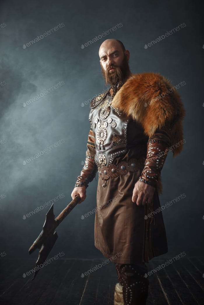 Viking with axe, barbarian, side view