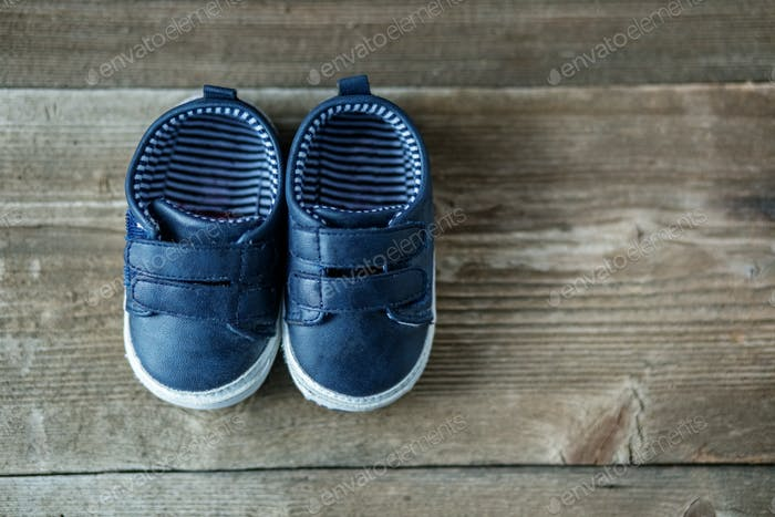 Fashionable modern baby shoes. Concept of care, baby, motherhood