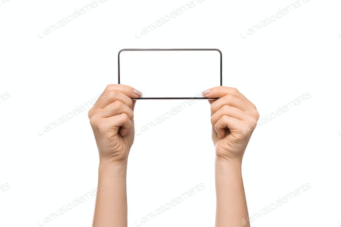 Smartphone with blank screen in horizontal orientation in woman's hands