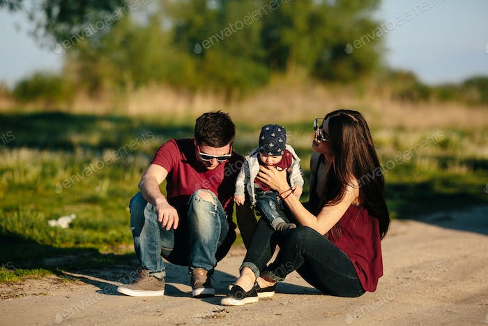young family with a child on the nature