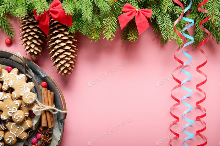 Flat lay design of Christmas greeting card of fir twigs bows con
