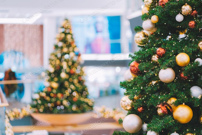Christmas trees with red and golden decoration in shopping mall