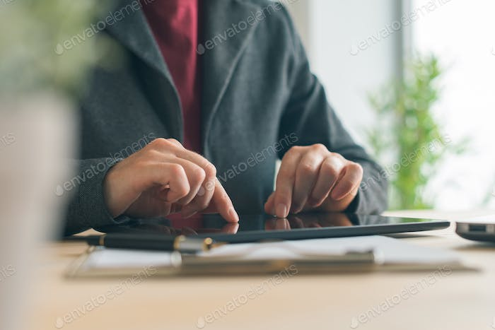 Businesswoman using tablet in business office