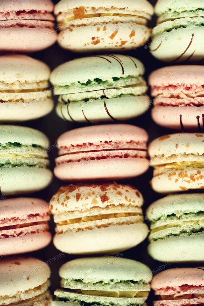 Colorful french macaroons flat lay. Pastel colors pink, green, yellow macarons with copy space, top