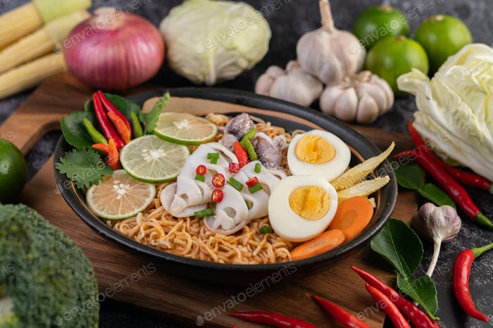 Tom Yum Mama with Squid and Boiled Egg.