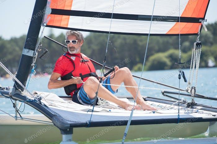 Senior man on sailing vessel