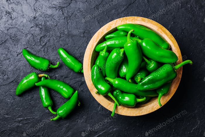 Green jalapeno hot pepper in wooden plate