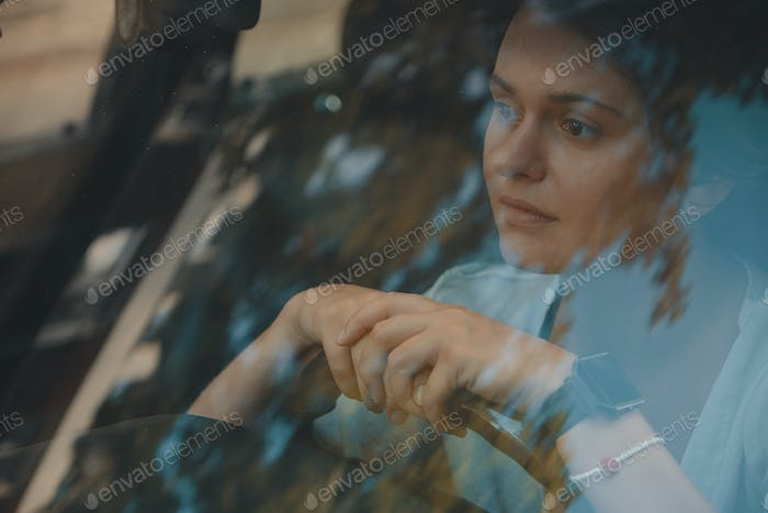 Smiling woman driving car, attractive girl sitting in automobile