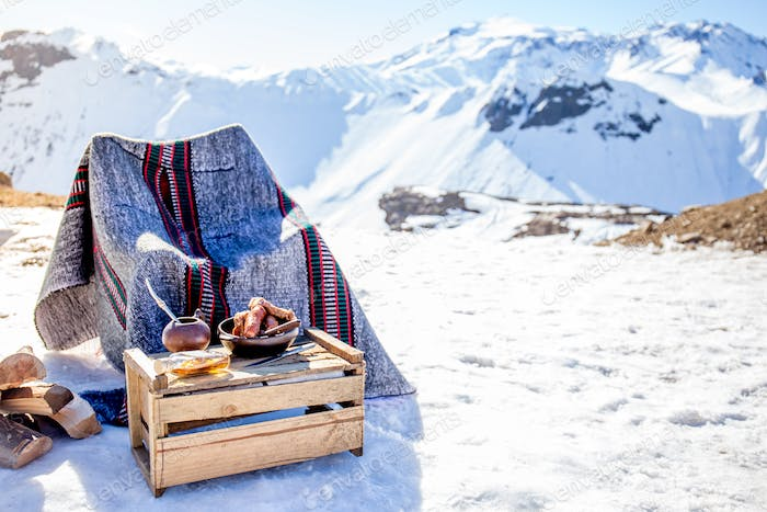 Winter picnic in chilean argentine with hot meat food and drink yerba mate