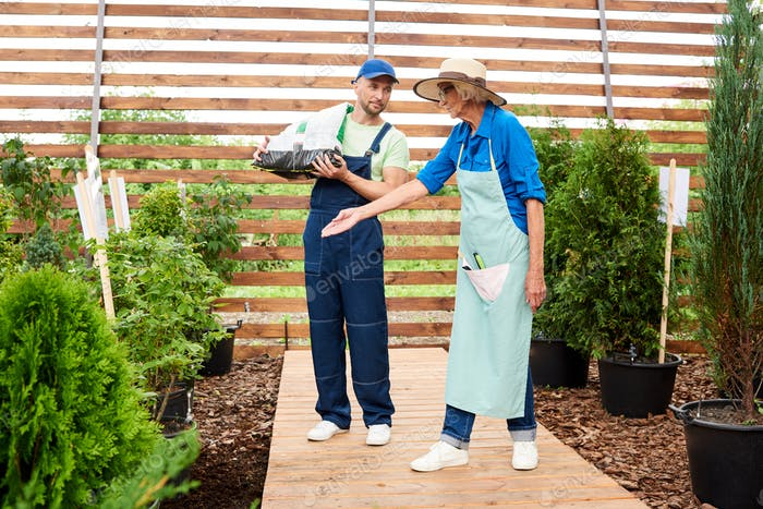 Two Workers in Garden