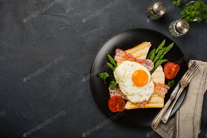 Fried egg with bread toast and asparagus