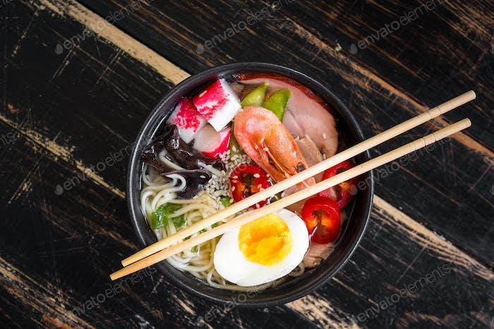 Asian noodle soup in a black bowl
