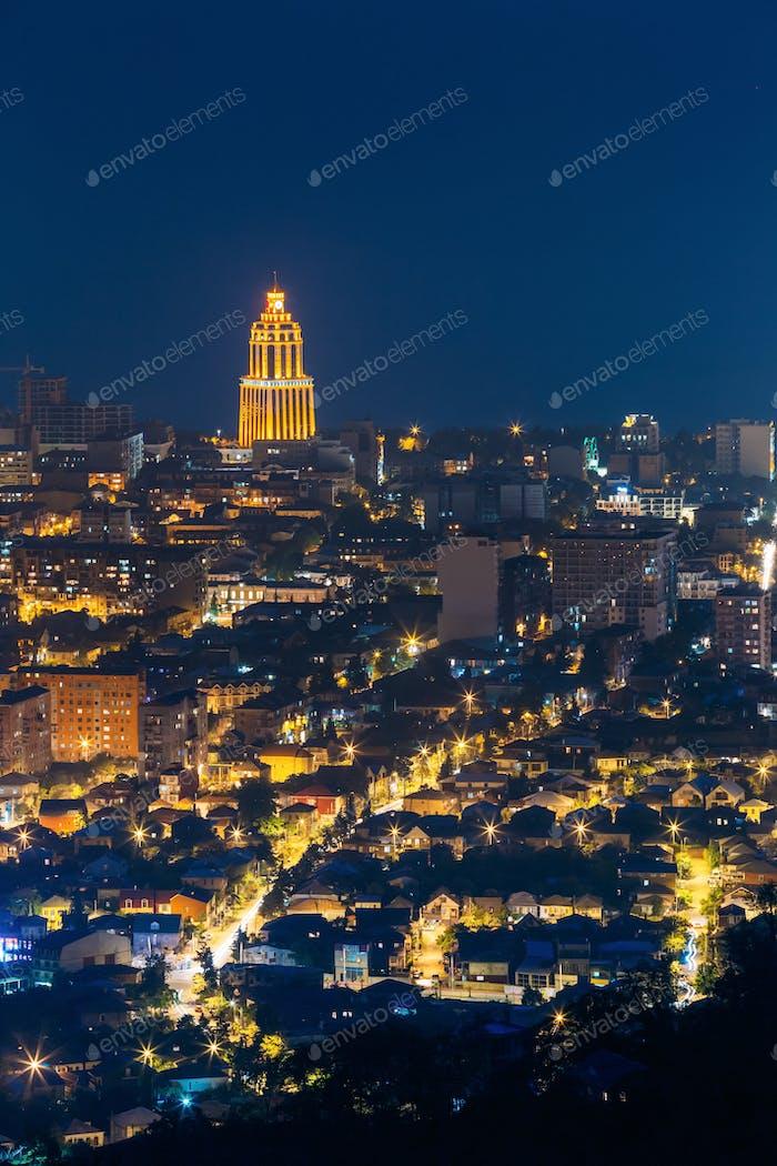 Batumi, Adjara, Georgia. Aerial View Of Urban Cityscape At Evening Or Night. Night Illumination