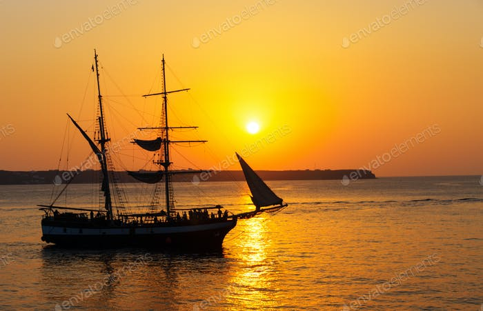 Sunset with sailing ship