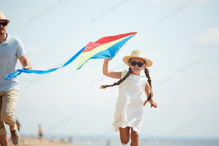Playing kite with father