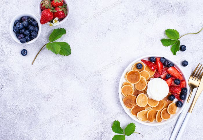 Sweet tiny pancake cereals with berries