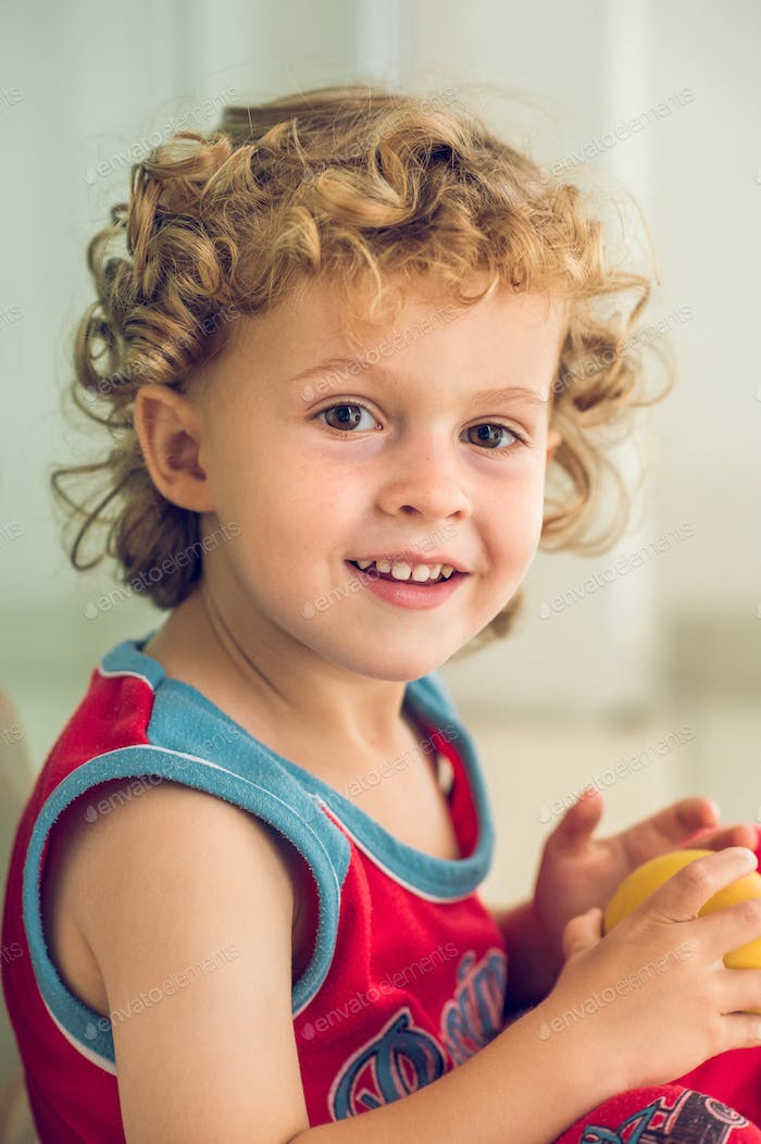 Cheerful little boy with ball