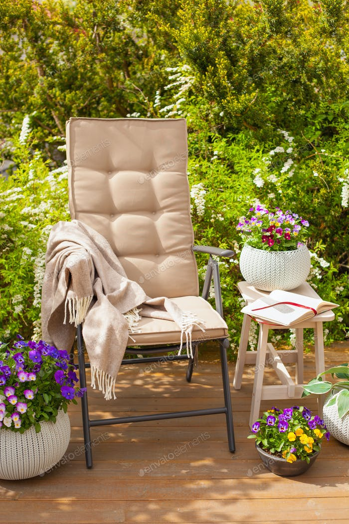 garden chair on terrace, relax, flowers