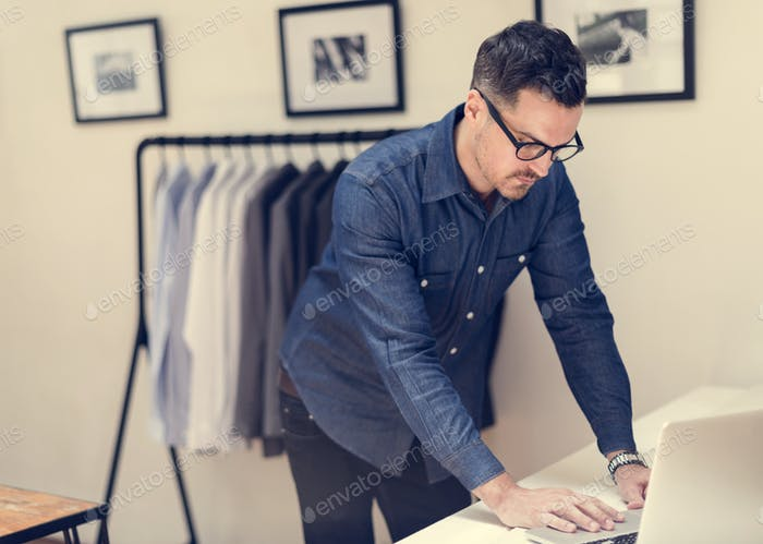 Man working in retail cloth shop