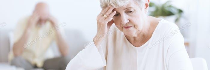 Worried and sad senior woman