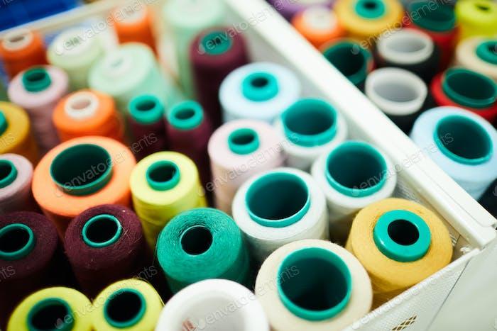 Many spools of bright threads