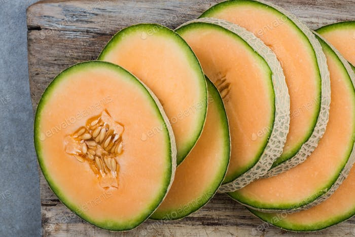 Cantaloupe melon slices on board