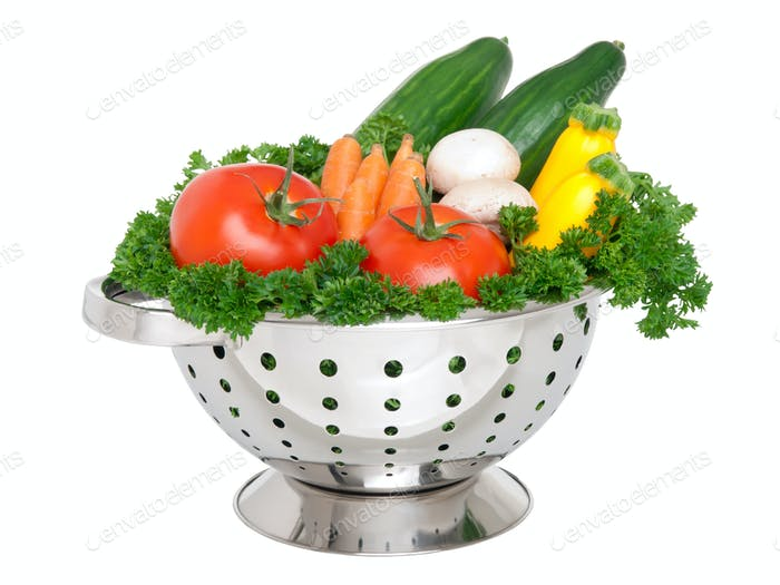Fresh vegetables in colander
