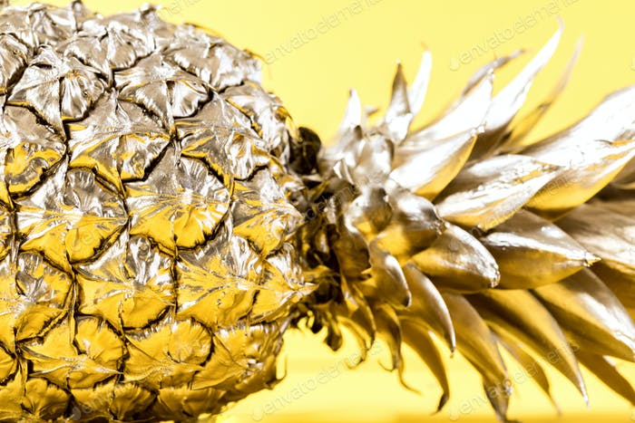 Creative layout made gold pineapple.Minimal style.  Tropical Food concept.