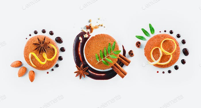 Cookie decoration flat lay. Food styling tips pattern made of cookies, chocolate swooshes and rings