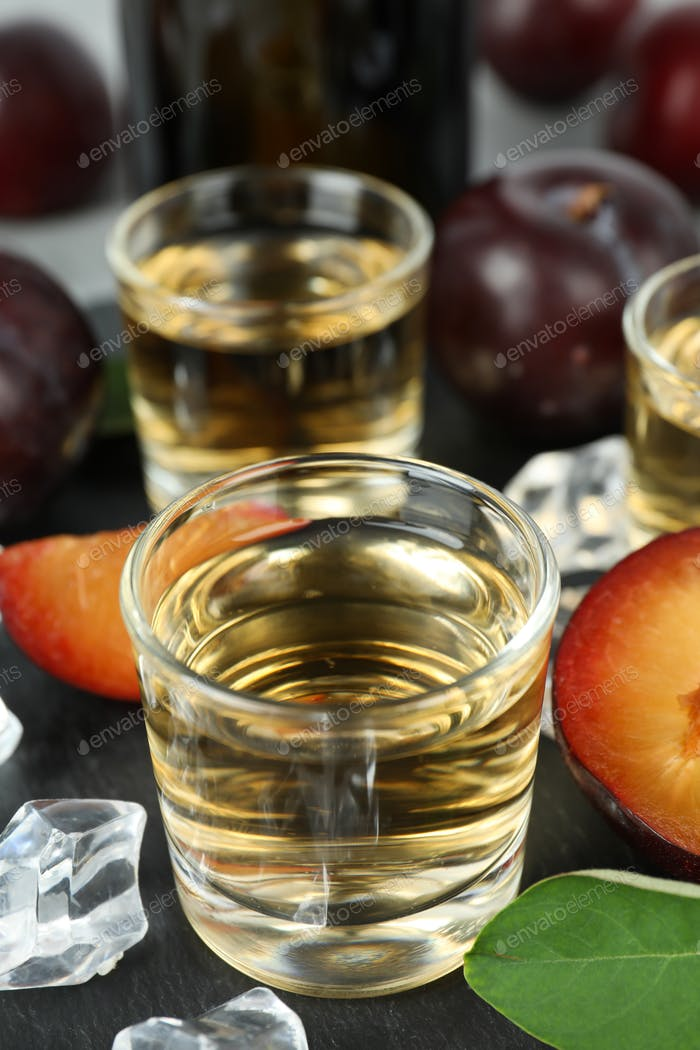 Concept of alcohol with plum vodka, close up