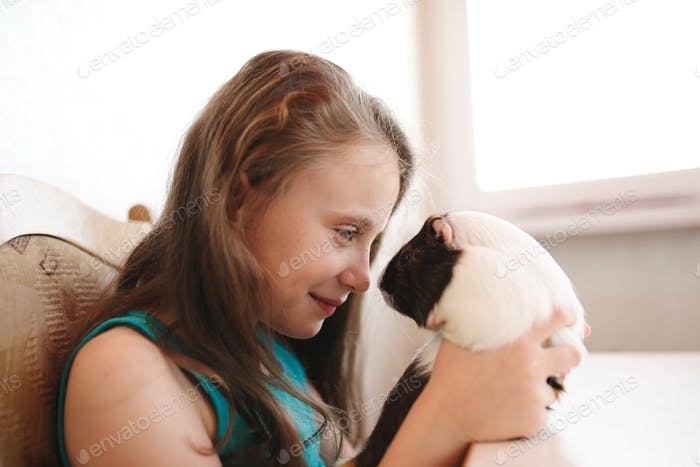 little beautiful girl with guinea pig