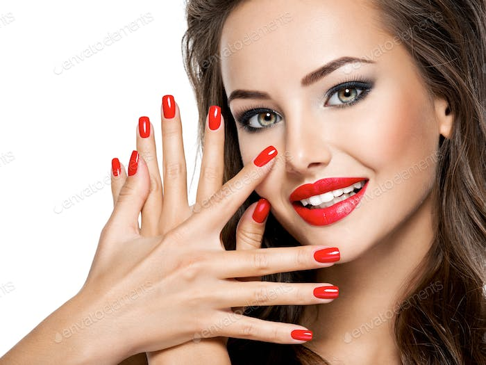 beautiful smiling woman with red nails