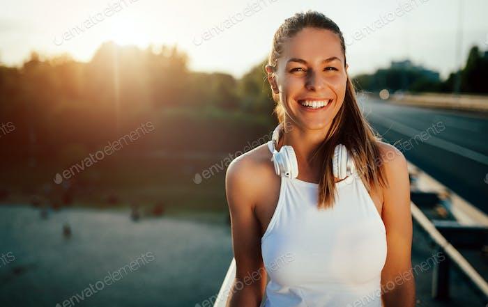 Beautiful woman running over bridge