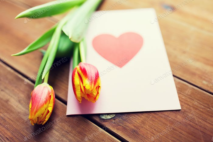 close up of flowers and greeting card with heart