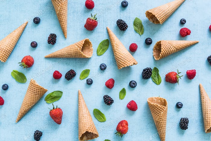 ice cream cones and fresh berries, summer background