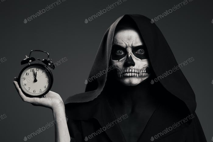 Thumbnail for Scary Death Hold A Watch In His Hand. Realistic Skull Makeup.